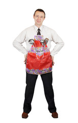 Man in the apron with kitchen accessories