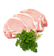 pieces of meat and bunch of parsley isolated on white background