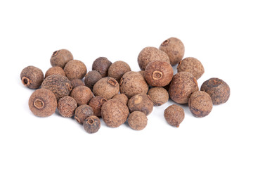 Pile Allspice (jamaica pepper) isolated on white background.