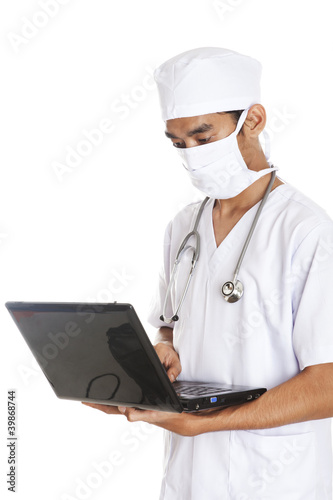 Surgeon with computer laptop