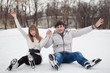 Couple having fun on ice skate rink outdoors.