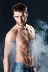 young sporty man over Smoke