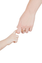 Young child hand holding adult hand. On clean white background.