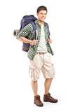 Full length portrait of a hiker with backpack posing