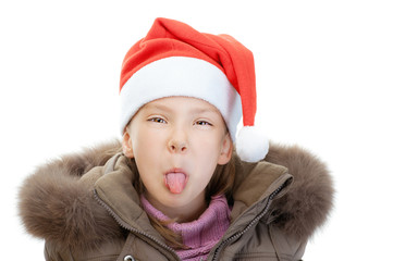 Little girl in Christmas hat show tongue