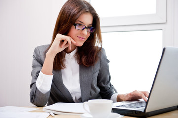 Business woman working on computer at her office