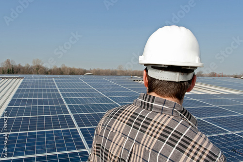 Worker looking at a photovoltaic plant