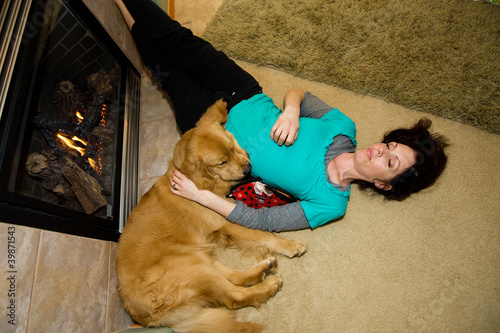 Woman and Dog sleeping on the floor