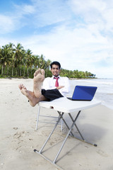 Businessman relaxing at beach