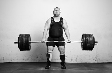Champion Powerlifter with strong arms lifting weights