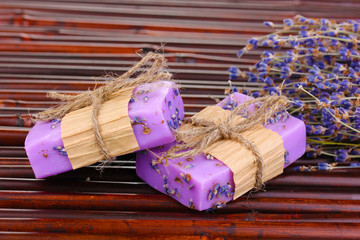 Hand-made lavender soaps on bamboo mat
