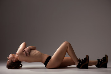picture of healthy naked woman, lying on the floor