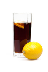 glass with cola and lemon