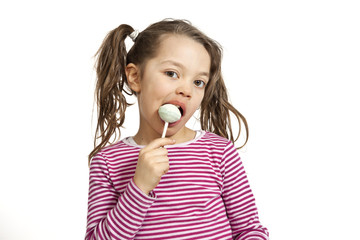 portrait of little girl with a lollipop on white background