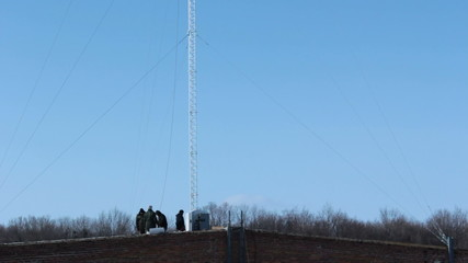 Team working near mobile tower