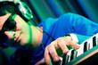 DJ mixing music at disco