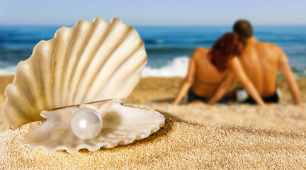 shell with pearl, couple on the beach