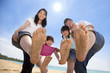 happy asian family enjoy summer time on the beach
