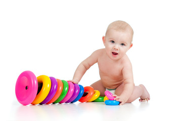 smiling child playing with color toy
