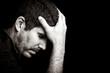 Worried or depressed young hispanic man