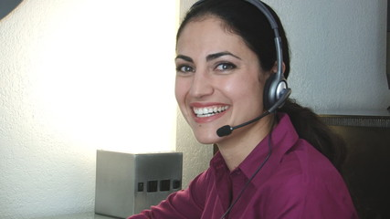 Close up of smiling customer service woman with headset