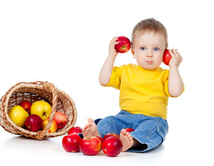 funny little child boy with healthy food fruit