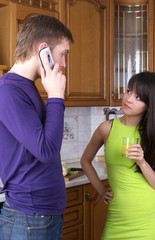 Young couple discussing something at home kitchen