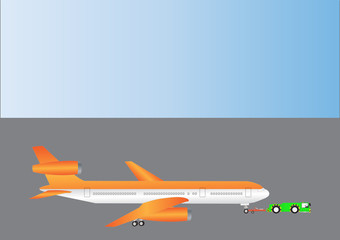 An Orange and Silver Airliner being towed by a Pushback Tractor