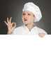 Young female chef with banner