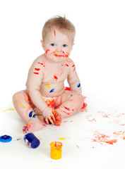 Happy dirty child with paints. Isolated on white background