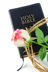 holy bible and crown of thorns with  rose