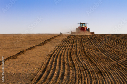 Foto op Aluminium Cultuur Agriculture tractor sowing seeds and cultivating field