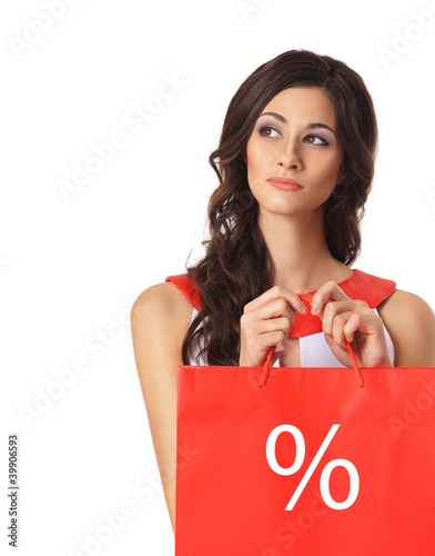 Portrait of a young brunette woman with shopping bags