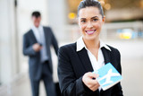Fototapety attractive businesswoman handing over air ticket at airport