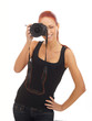 A young and attractive redhead female photographer
