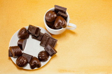 Cup full with chocolate candies