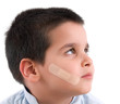 Band aid on face of a child