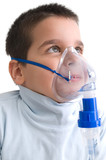 Cute little boy using nebuliser for asthma.