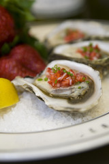 Oysters with strawberry mignonette vinaigrette on ice