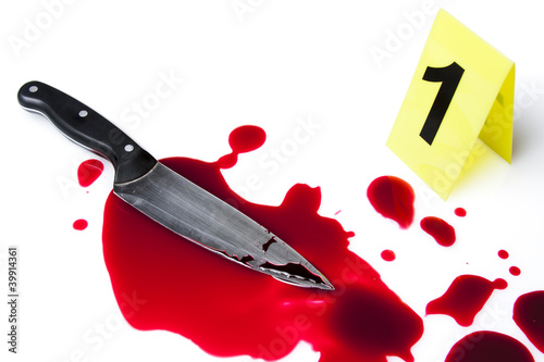 evidence marker with blood and knife isolated on white