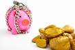 Chained piggy bank and gold