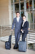 two young business travellers at airport