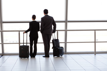 silhouette of two businesspeople at airport