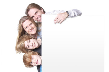 Happy family with white message board
