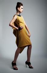 Fashion photo of beautiful stylish woman in yellow trendy dress