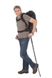 Senior man with backpack and hiking poles