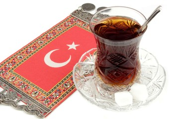 Turkish tea with traditional crystal tea glass and turkish flag