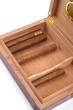 A part of opened humidor with cigars isolated on white backgroun