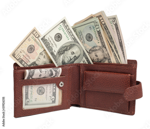 Dollars in brown wallet isolated on white