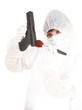 woman in white, protective uniform and mask with gun
